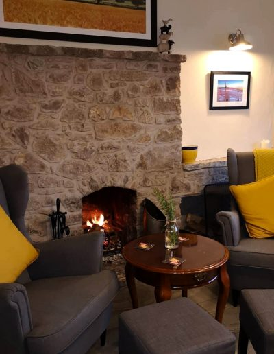 Relax next to the fire at the Nant y Felin